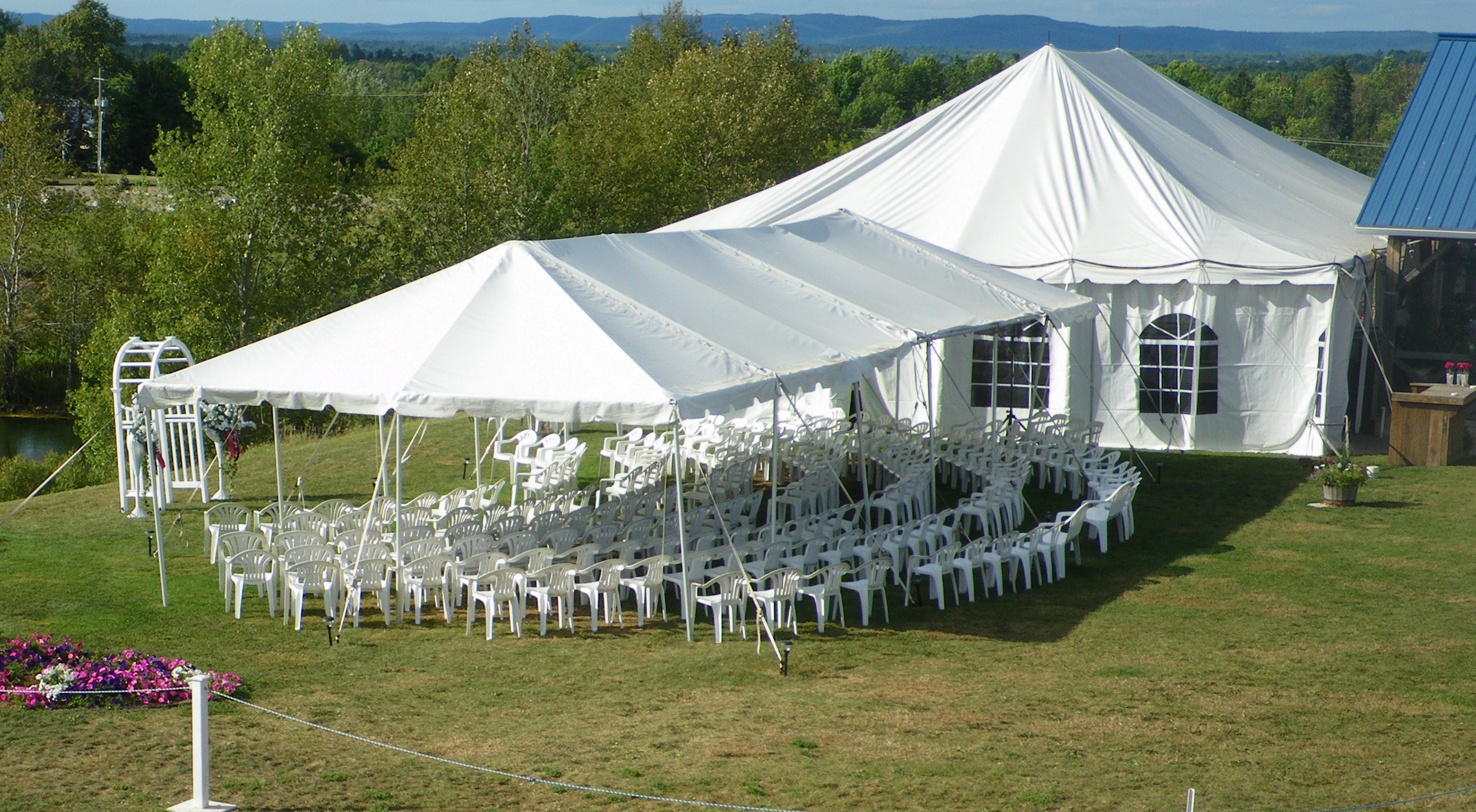 Hugli's has beautiful, white garden tents with clear windows for on-site weddings at Hugli's Blueberry Ranch in Pembroke.